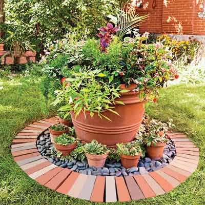 Create A U201cstageu201d To Highlight A Large Flower Pot By Placing Bricks In A  Circular Pattern Larger Than The Pot. Add Pebbles Stones And Place Small  Flower Pots ...