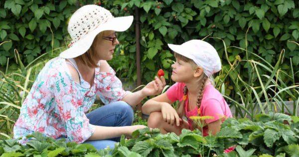 kids gardening - mother and daughter in garden