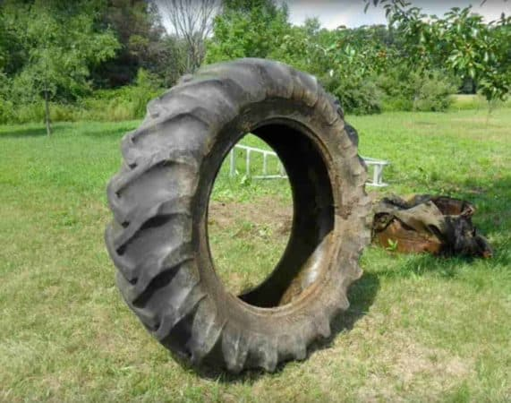 Old tractor tire used to create a pond