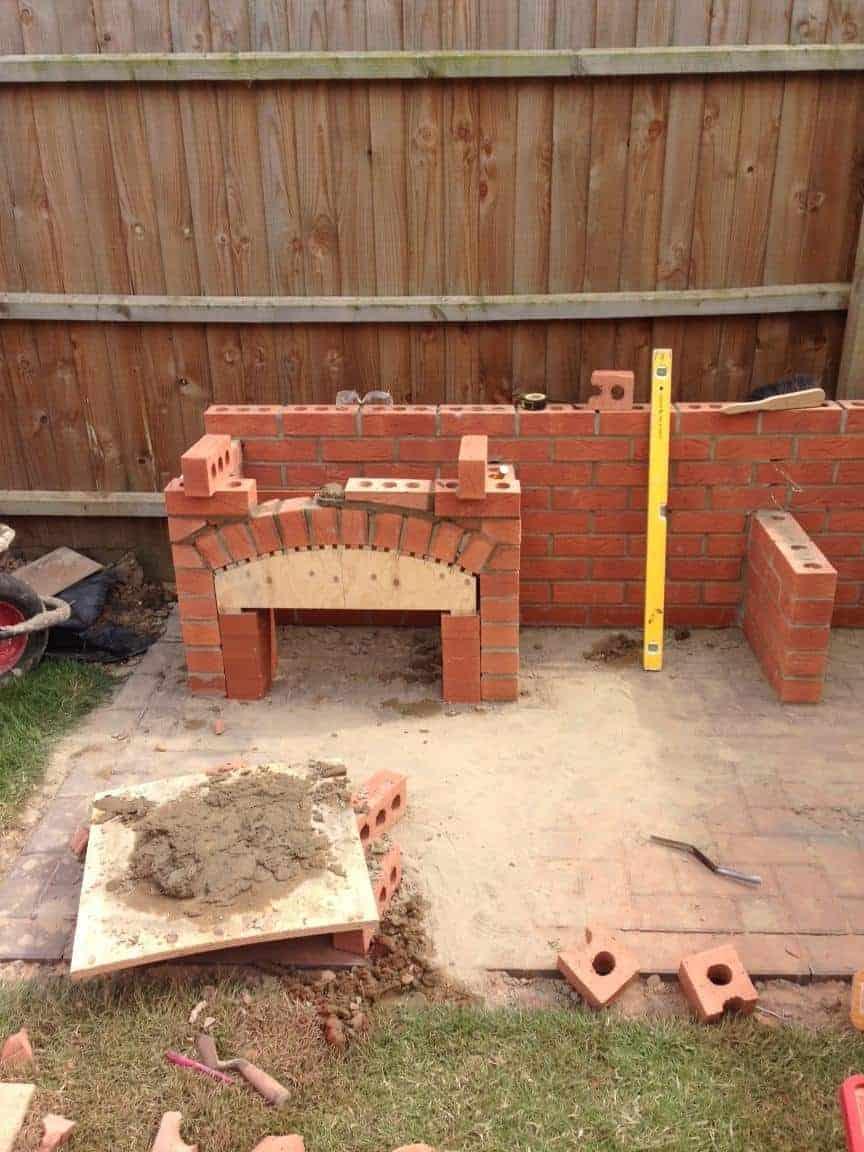 he takes a pile of bricks creates a stunning brick bbq perfect