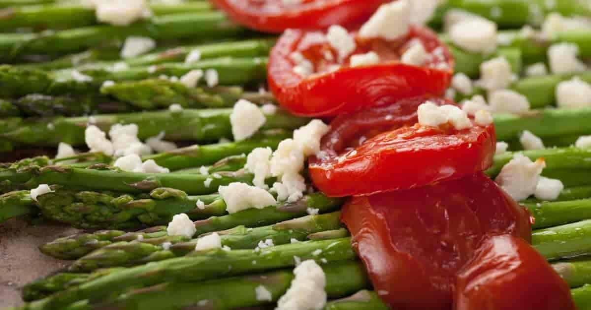 tomatoes on top of cooked asparagus