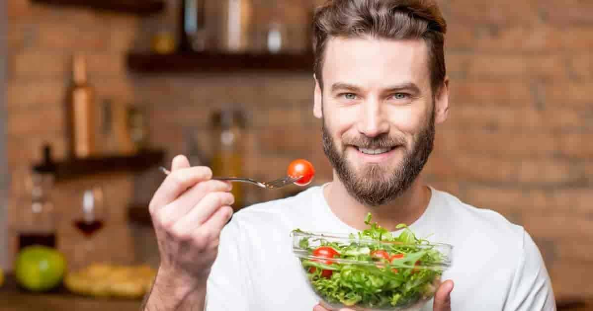 man enjoying tomato health benefits with his salad